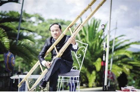 vietnamese witch  musical instruments  hold