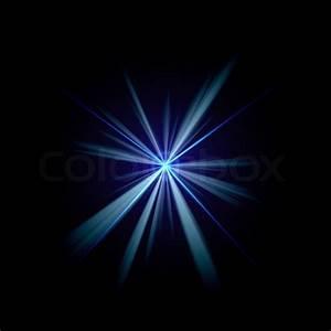 Bright blue flash of light or lens flare burst over a ...