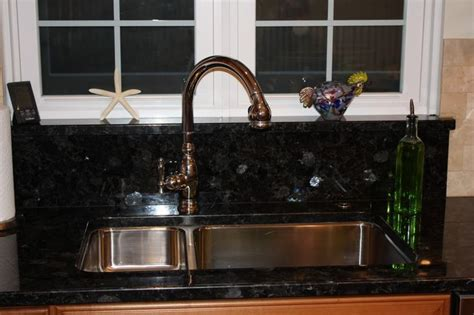 granite  faucet  window sill didnt  grout   sink  heres