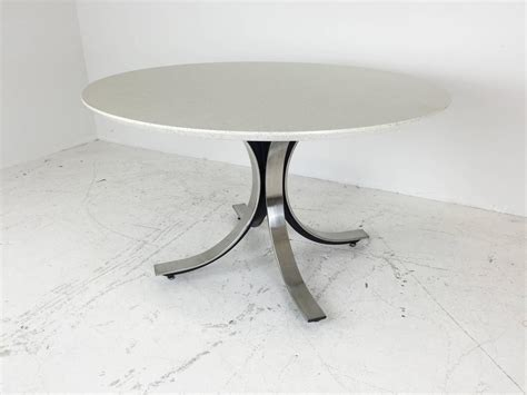 Four Legged Chrome Base Round Dining Table With White