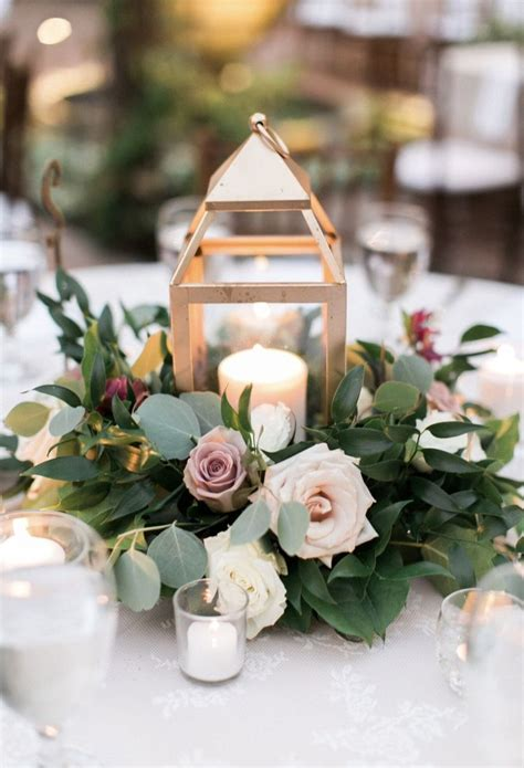 Gold Lantern Centerpiece With Ring Of Flowers And Greenery