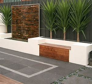 Bench seat along house brick wall love this water for Garden feature wall ideas