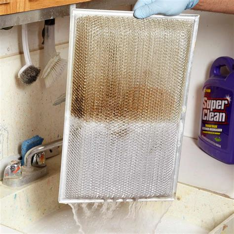 clean greasy kitchen range hood filter