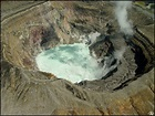 An aerial view of the active crater of Aso Volcano ...