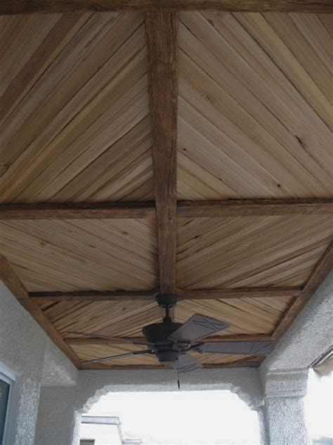 covered patio  faux wood beam  plank ceiling