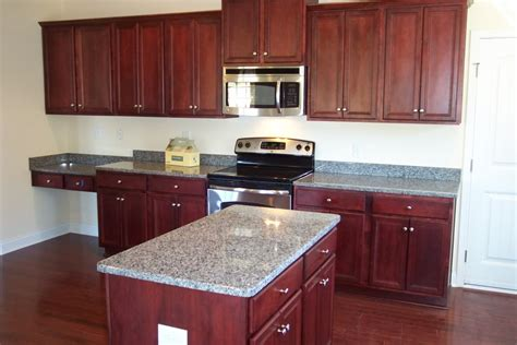 cherry cabinets with gray countertops caledonia granite countertops with cherry cabinets http