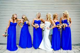 blue bridesmaids dresses throw a proper summer wedding with yellow and royal blue knots and confetti