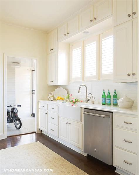 ivory painted kitchen cabinets ivory kitchen cabinets with farm sink and louvered window 4885