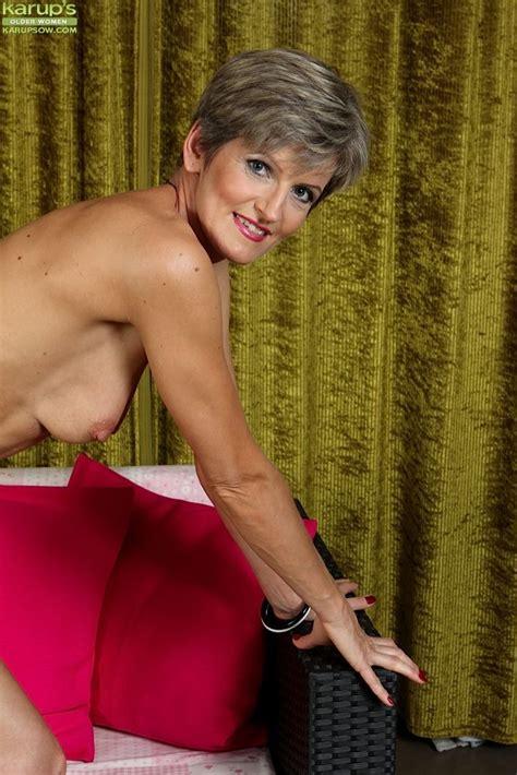 Older Woman Melanie Pulls Her White Panties Aside And