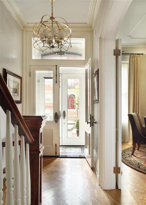 white traditional brownstone foyer  gold chandelier hgtv