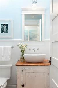 distressed bathroom cabinets cottage bathroom jodi With best brand of paint for kitchen cabinets with blue hydrangea wall art