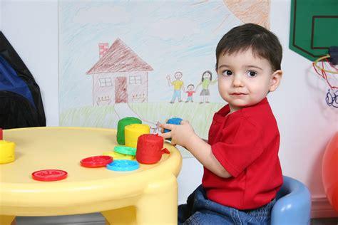 developmental activity a day 24 36 months teis inc 832 | bigstock Adorable Preschooler Playing W 27987