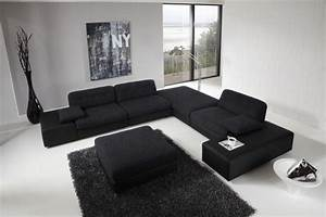 Large black sofa for modern living room design with high for Modern furniture design for living room
