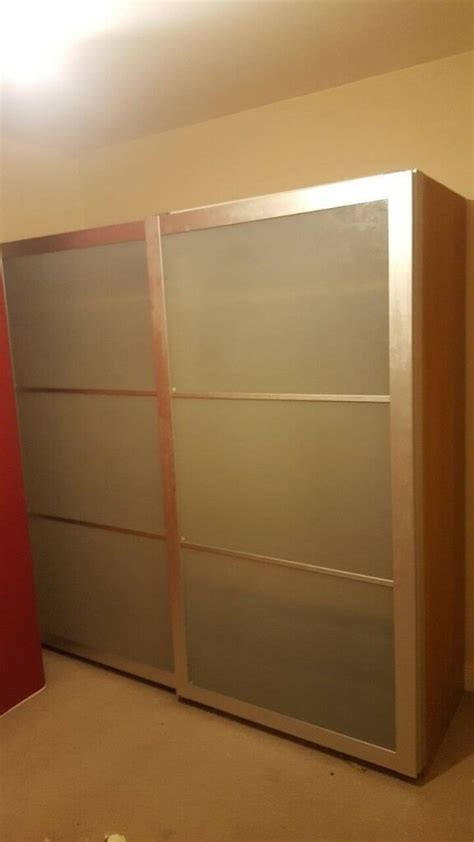 Wardrobe With Shelves Only by Free Wardrobe With Glass Sliding Doors Baskets And