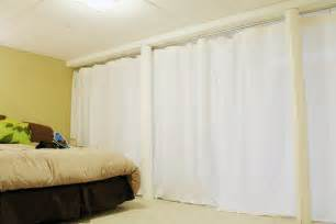 curtain track system used as a room divider in our