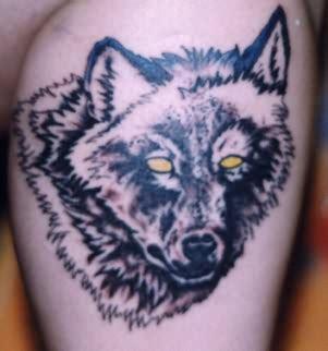 yellow eyes wolf tattoo