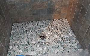 Pebble tile bathrooms bathroom tile for Pebbles on shower floor