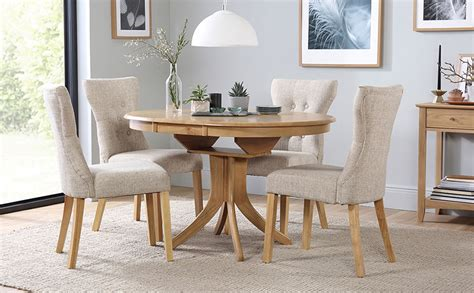 round extending dining table sets hudson round extending dining table 4 chairs set bewley