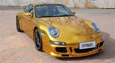 gold porsche convertible porsche 911 wrapped in gold foil spotted in china