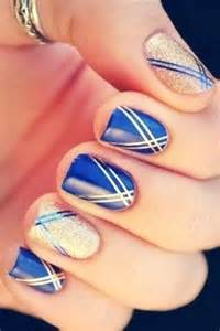 Blue and gold nail art beauty fashion