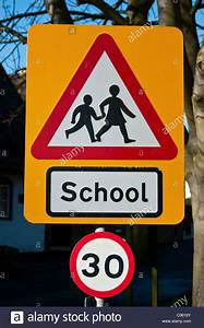 Road Sign Warning Of Children Crossing Near A School  And