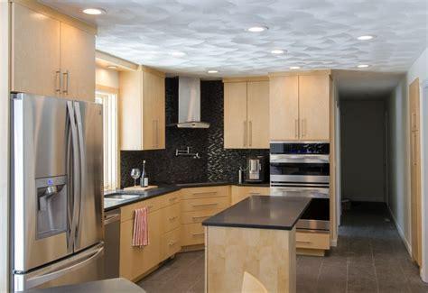 Birch Cabinet Kitchens   Corner cook top, stainless steel