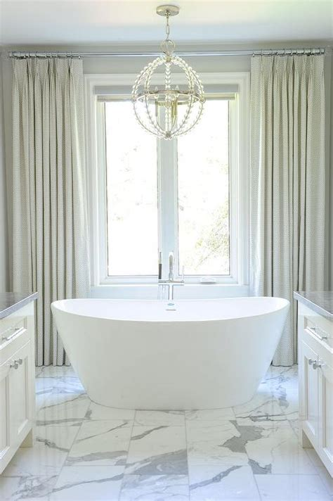 gray curtains behind tub transitional bathroom