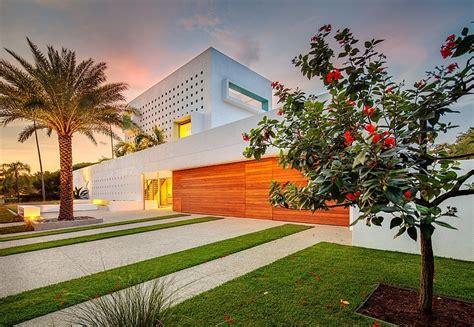 tall florida home  open indoor outdoor hallways