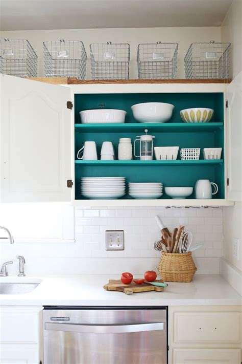 how to paint inside kitchen cabinets nesting colored kitchen cabinets a beautiful mess