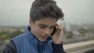 Good Looking Teenage Boy Talking On His Smart Phone ...