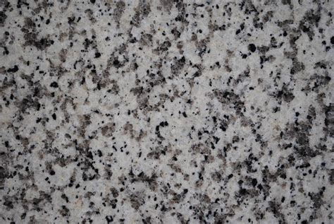 silver wall granite counter tops and custom cabinetry prostone