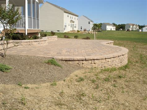 Paver Brick Wall by Elevated Paver Patio With Retaining Wall For The Home