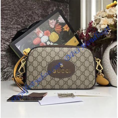gucci gg supreme messenger bag  brown  yellow leather trim