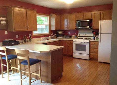 oak and black kitchen cabinets kitchen paint colors with oak cabinets and black