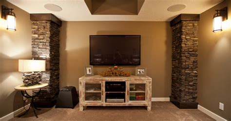 Media Room With Rustic Console And Stone Pillars