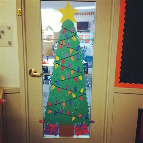 diy christmas tree classroom door decorations classroom door handprint tree student names are on the lightbulbs names are