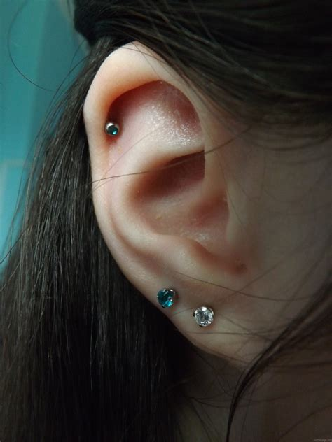 Lobe Piercing With Colorful Studs