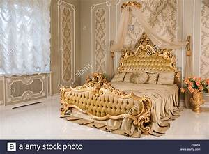 Luxury Bedroom In Light Colors With Golden Furniture