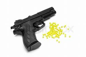 Toy gun with pellets isolated | Stock Photo | Colourbox