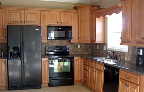 kitchen cabinets with black appliances black kitchen appliances with light wood cabinets home 8165