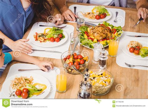 table cuisine angle high angle view of family with food on dining table stock