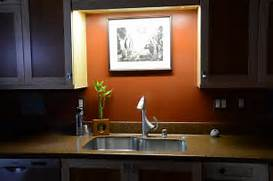 Pics Photos Neatly Sink Kitchen With Over Sink Center Design Ideas Images Of At Collection Design Kitchen White Backsplash Kitchen Window Sill Home Design Ideas Renovations Photos Bathroom Storage Cabinet 45 Surprising Dry River Bed Landscaping Ideas