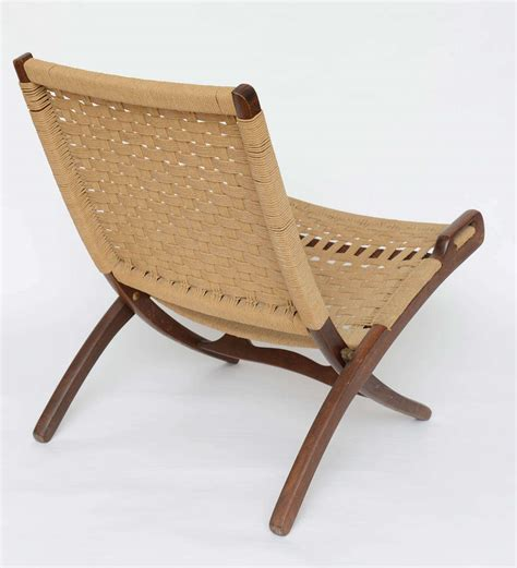 pair of wegner woven folding rope chairs 1950s image 6
