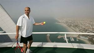 Andre Agassi And Roger Federer Playing Tennis On Helipad ...