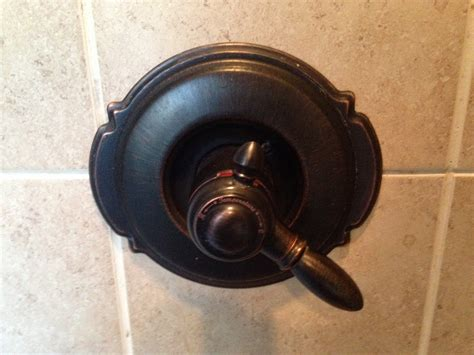 remove  price pfister shower faucet rooter guard