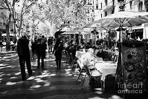 People Walking Down Through Street Cafes On La Rambla ...