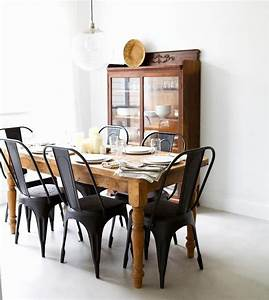 matte black chairs with a rustic wooden table from With metal dining chairs wood table