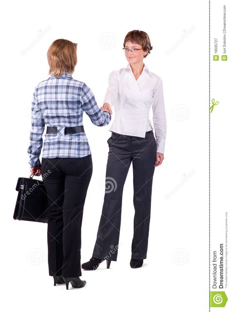 business women shaking hands royalty  stock