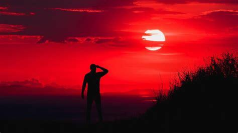 Man Silhouette In The Ablaze Sunset 4k Ultrahd Wallpaper