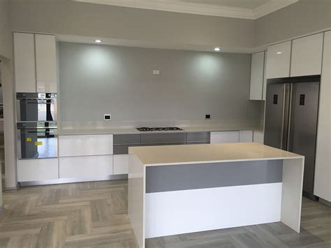 Installing Kitchen Cupboards by Built In Cupboards Durban